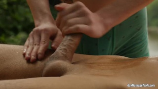 redhead masseur gets client revved up on massage table