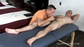 Jayden gets serviced on massage table
