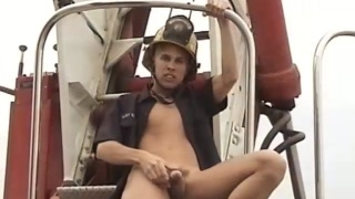 young fireman jacks off on a fire truck