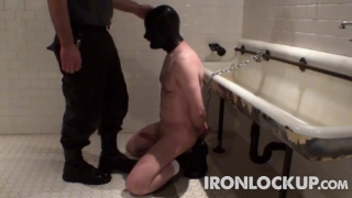 slave kneels on wetroom and sucks master's cock