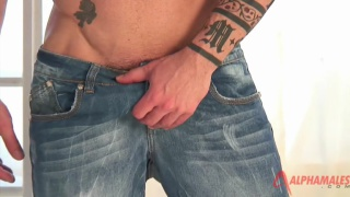 massive muscle hunk pulls his cock out of his jeans