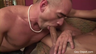 Shaved head white guy fucks tanned surfer dude