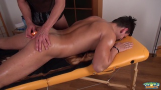 masseur sticks sex toys in his client's ass