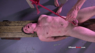Roped dude busts a huge load after C&B torture