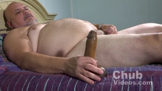 Big Daddy Jimmy plays with dildo