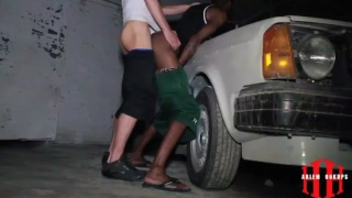 grindr top pushes his bottom over a car in garage