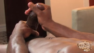 sexy black stud fists his super fat dick