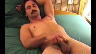 handsome man Robert strokes his cock
