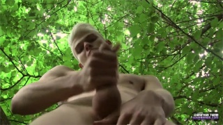 blond lad strokes his fat dick in the woods