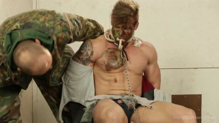 bound captive sucks soldier's cock