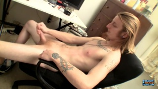 long-haired blond gets playful with his cock
