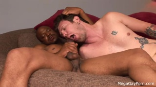inked white boy takes a black dick on the couch