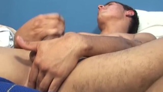 Marcos stroking his uncut cock