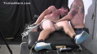 Graham strapped down and tickled