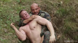 soldier strips a hiker in the forest