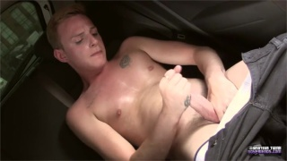 cute guy jacks off in back seat of his car