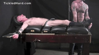 Muscular businessman Ronan Geiger restrained and tickled
