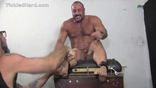 powerlifter restrained and tickled