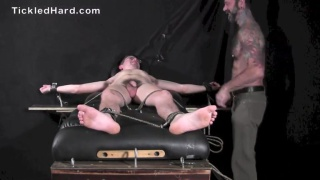 22-year-old guy squirms on the tickle table
