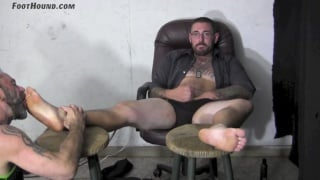 Lane removes his cowboy boots and gets feet worship