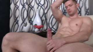 sportsman plays with his big, uncut dick