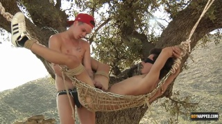 Charley Cole fucks Cairo Jordan while hanging in a tree