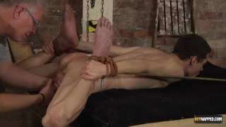 young slave gets punishing hot wax session