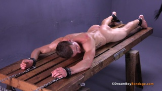 jared roped to a rack and flogged