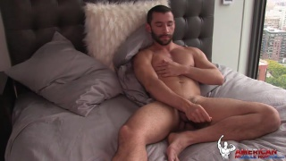 Luca rubs his beautiful muscles and cock