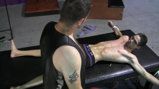 leather daddy has his fun with bound lad
