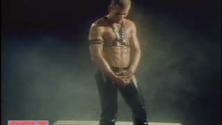 Will Garret in leather harness
