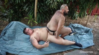 bear riding cock in outdoor fuck scene