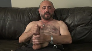 hairy-chested bald daddy Jacks Off