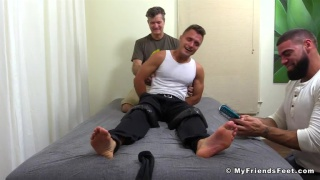 ricky larkin tickles guy's bare feet with a brush