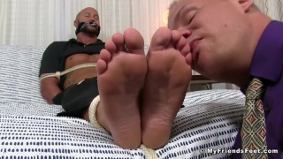 employee ties up his boss and worships his feet