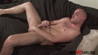 tattooed skinhead Cody Lines jerks his 8 inches