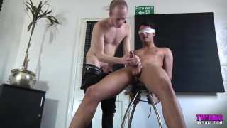 blindfolded Felix Chase gets his cock stroked