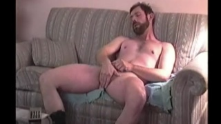 hillybilly jerks his cock in his cowboy boots