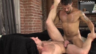 2 men kiss with Alex Mecum and Adam Ramzi