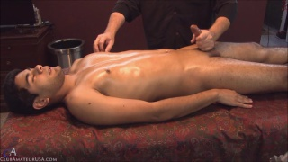 kato gets serviced on massage table