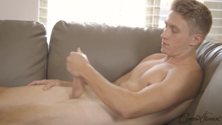18-year-old stud jacks off on the couch