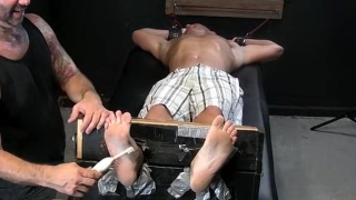 Dirk gets his feet tickled and caned