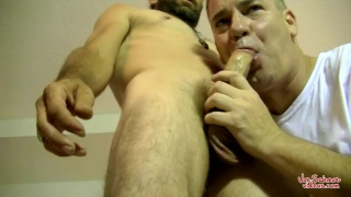 hairy bearded bisexual man gets head from a guy