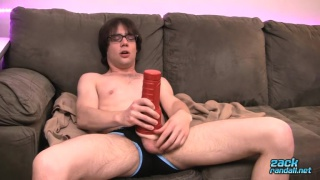 Zack Randall Fleshlights his big cock with a red sex toy