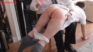 head master takes student over his knee for bad grades