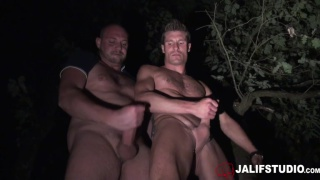 guy and his coach head into the woods for some hot sex