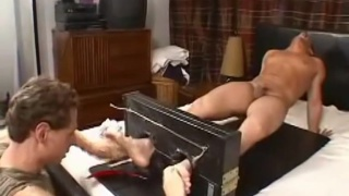 tough guy gets his bare feet tickled