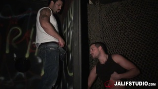 man at glory hole moves around to fuck his cocksucker