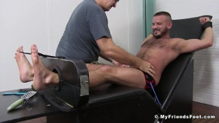 Sean Harding in the tickling chair