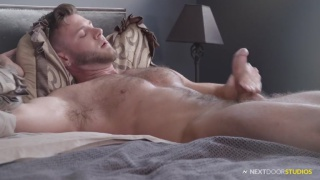 hairy hunk James Ray jacks off in bed